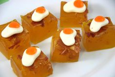 How to Make Bacon and Eggs Jello Shots. If you're looking for a unique treat for a brunch get-together, bacon and eggs jello shots can be an excellent choice. These shots are made with bacon-infused bourbon, bacon bits, gelatin, and gummy. Breakfast Shot, Jelly Shots, How To Make Bacon, Alcoholic Desserts, Pudding Shots, Pineapple Upside Down Cake, Caramel Flavoring, Bacon Bits, Jello