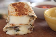 Oaxacadillas! Oaxaca cheese rolled up with poblanos and sauteed mushrooms...gooey and wonderful.