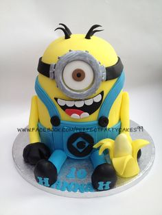 Daughters minion cake. Over 9 inches tall