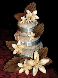 Paper cake with origami flowers   A baby shower gift made from disposable  diapers, ribbon, and paper flowers How clever