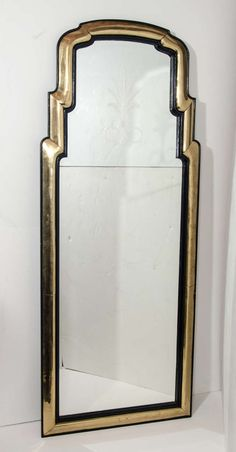 Pair of Unique Antique French Art Deco Gilt Bronze and Ebony Mirrors | From a unique collection of antique and modern wall mirrors at https://www.1stdibs.com/furniture/mirrors/wall-mirrors/