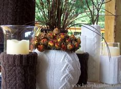 Upcycle sweater sleeves onto vases and candles for easy Fall and Winter decor: