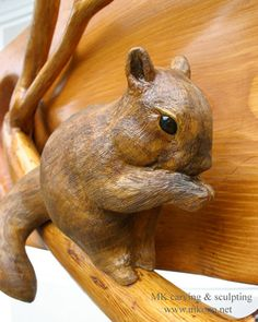 "Title: ""Squirrel on branch""   Entrance beam for Timber Frame house  Material: Douglas fir, Walnut, Cedar  Size: WxHxD: 30""x 10""x 4""    (76cm x 25cm x 10cm)"