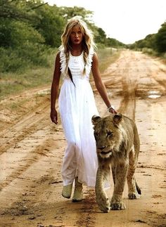 The essentials, long white dress and a wild cat.