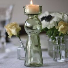 Pastel green glass bottle tea light holders available from @theweddingomd