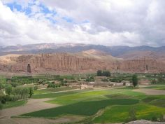 "Bamiyan Valley - with two empty niches where giant Buddha's once stood.  UNESCO, will ""...transform the site into a sanctuary where the international community can meditate on the losses of cultural heritage and contemplate how to change the pattern of destruction that leaves the world without a past..."""