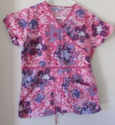 b3d8639b5a2 V Life Scrub Top Pink Paint Splash Floral Purple Size XS Bust. Special  Features: Mock wrap, tie back, v neck, side slit.