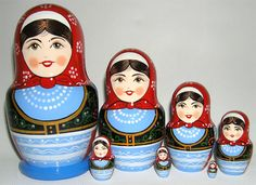 Hand painted, lacquered 5 piece babushka doll depicting ladies in Belorussian national dresses.