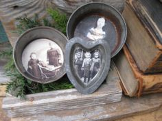 Interesting idea of what to do with some of the old family photos... maybe even find a way to drill a hole and hang on the Christmas tree. Set of 3 Early Antique Dark Tin Toy Pans w Old Photos