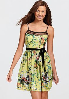 Green flowered summer dress. Would be really cute with a black or brown sweater on top!