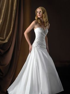 Allure Bridals Romance 2358 Taffeta Wedding Dress. This fabulous a-line gown is constructed from our luxurious taffeta. The fitted bodice features asymmetrical ruching and sparkling crystals at the ne
