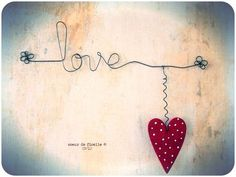Wired love with wooden heart...