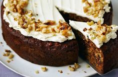 This date and walnut cake is a real teatime treat - moist sponge dotted with dates and walnuts, topped with a creamy frosting. Date And Walnut Cake, Coffee And Walnut Cake, British Baking Show Recipes, Baking Recipes, Baking Ideas, Uk Recipes, Baking Tips, Sweet Recipes, Iced Fairy Cakes