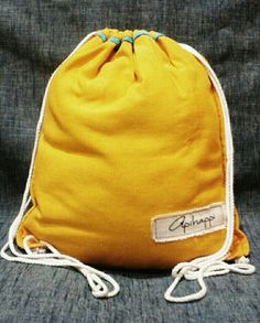 A unique handloom, Stringy bag from Sri Lanka - in Golden Yellow with a Turquoise Blue with White string -The Spongebob