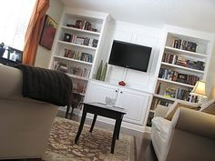 love the molding behind the tv., drawers on the bottom, doors on top...