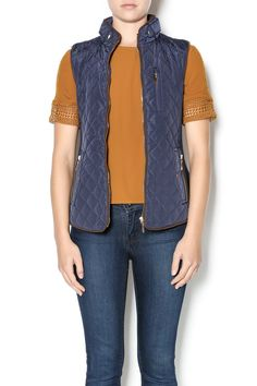 Navy equestrian style light weight vest with detail buttons and zip pockets.The sides are knitted which allows some give in the vest. Quilted Vest by Charlie Paige. Clothing - Jackets, Coats & Blazers - Vests Virginia