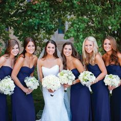 Navy Jim Hjelm Bridesmaid dresses with White bouquets // Heather Ann Design & Photography // College Flowers // http://www.theknot.com/weddings/album/a-classic-elegant-wedding-in-lubbock-tx-125796