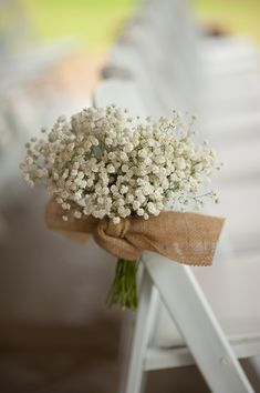 Baby's Breath is hardy and affordable - perfect for the DIY bride! This is a charming look to mark the aisle - a cluster of Baby's Breath tied off with a burlap ribbon. Baby's Breath is available year-round at GrowersBox.com!
