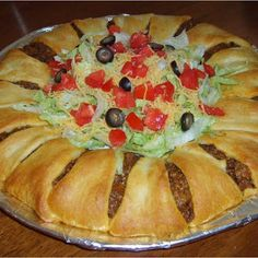 Pillsburys Crescent Roll Taco Bake - 2 crescent roll tubes 1 LB ground beef (or ground turkey) 1 packet of taco seasoning 1 1/2 cups grated cheddar cheese Shredded lettuce 1 or 2 diced tomatoes depending on size 1/2 small can sliced olives if desired Sour cream optional sliced avacado optional