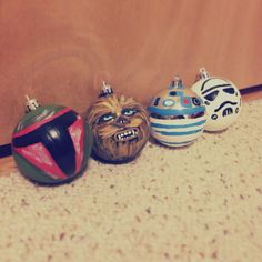 DIY star wars ornaments. Not bad for a first attempt! :) cheap dollar store bulbs + walmart acrylic paints. Boba fett, chewy, r2d2, storm trooper christmas