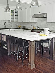 like this thought for their kitchen.  island is spacious and usable, so good for their small kitchen.  white top with painted legs will keep space light colored, but still grounded.  Kitchen island and table