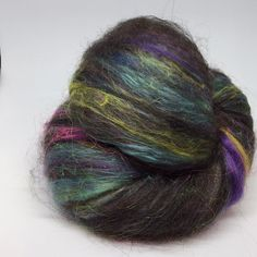 Black Wensleydale hand-dyed silk brick fire star and some mohair make this batt one of my all time favourites. Made for the Northern Lights Fantasia Fibre Club