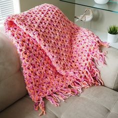 Quick. Easy. Cozy. And perfect for a beginner. Get the free crochet afghan pattern at: http://dabblesandbabbles.com/easy-cozy-crochet-blanket/