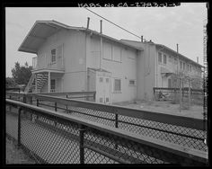 View of south and west elevation of Building No. 28. Looking south - Easter Hill Village, Building No. 28, West side of Corto Square, Richmond, Contra Costa County, CA