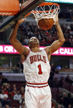 2a9d8d0bc76f Chicago Bulls guard Derrick Rose scores against Utah Jazz during the first  quarter of an NBA basketball game in Chicago