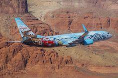 "Alaska Airlines Boeing 737-890 N570AS ""The Adventure of Disneyland Resort"" flies through Monument Valley in Arizona, January 2015. (Photo: Alaska Airlines)"