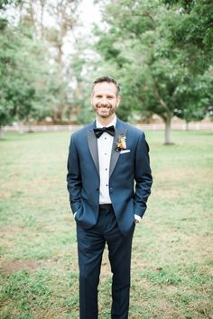 Looking dapper in a blue tux by The Black Tux: http://www.stylemepretty.com/california-weddings/2017/01/23/fall-walnut-grove-wedding/ Photography: Brooke Borough - http://brooke-borough.com/