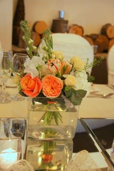 Beautiful posies of Roses, Stocks, Tulips, Ranunculas, Thalaspi and Sweet Peas in a variety of sizes looked perfect along the length of the top table