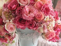 Love the hydrangeas mixed in with the roses and how the whole thing spills out of the vase