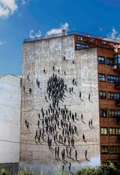 One of the most interesting art graffiti buildings found in the world is located in Spain. It is a building with graffiti created by the artist 'SUSO33' who designs squiggly line figures that depict shadows of people climbing the bare building wall. His use of quick gestural lines create a shadow effect that can be spotted from a distance.