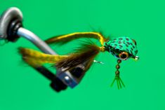 Here's one I just tied up over lunch.  I usually tie these swimming frogs with spun deer hair bodies, but I decided to tie one using foam to save time.  Also had an idea to use bead chain for front legs on the bottom of the hook shank to make sure it floats right side up.  This will also m…