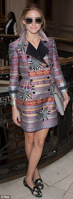 Making a statement: Olivia Palermo opted for a printed coat with a popped collar and seriously funky shades