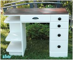 two tone desk, dark wood top and white paint on bottom with oil rubbed bronze hardware