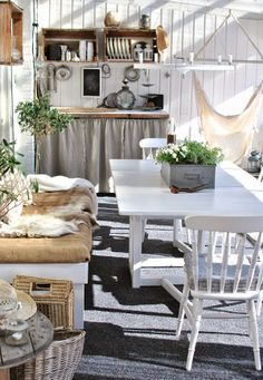 Sunny white outdoor kitchen with a reindeer skin covered bench and hammock for relaxing Rustic Outdoor Spaces, Outdoor Rooms, Outdoor Living, Outdoor Furniture Sets, Outdoor Decor, Rustic Room, Beach Cottage Decor, Summer Kitchen, Home Interior Design