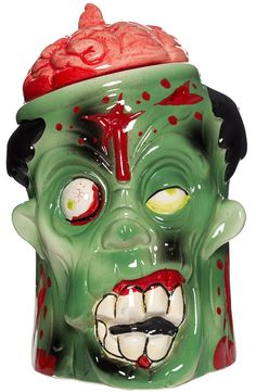 ZOMBIE COOKIE JAR  Add some spookiness to your kitchen decor with this ceramic zombie cookie jar! Oozing with lots of gory details, just pull out his brain to access whatever goodies you put inside. Made of ceramic, this jar also features a plastic rimmed lid to avoid chipping. $24.00 #housewares #cookiejar #zombie