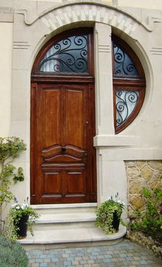 Gorgeous art nouveau inspired door and transom window.... some kind of a Fibonacci thing going on here!