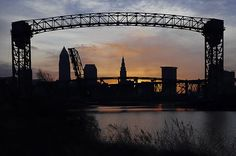 This was taken from Whiskey Island looking back at the Cleveland, Ohio skyline. At certain times of the year the sun rises directly behind the city as seen from this location and makes for a beautiful silhouette. One of my favorite aspects of the city are the many industrial lift bridges that line the Cuyahoga River. I love the way they play against the city skyline and at this location makes a a wonderful frame.
