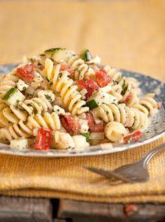 Greek Pasta Salad With Rotini, Tomatoes, Cucumber, Onions, Feta Cheese, Fresh Oregano, Fresh Parsley, Red Wine Vinegar, Olive Oil, Cracked Black Pepper, Salt