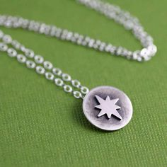 Sweet, Simple and Festive! This Tiny North Star Token Necklace in Silver is perfect for the holiday season but could also easily be worn year round! Its so feminine, delicate and sweet that it would seamlessly make itself a part of your everyday wardrobe!    A Tiny North Star