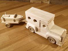 Wooden pickup truck with camper and boat on trailer toy
