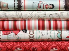 I've died and gone to heaven.  I just discovered Domestic Diva fabrics.