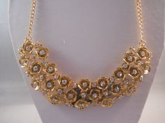 Hey, I found this really awesome Etsy listing at https://www.etsy.com/listing/216190471/bib-necklace-with-gold-tone-and-clear