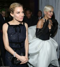 Backstage friends or foes? Sienna Miller and Rita Ora are seen side-by-side behind the sce...
