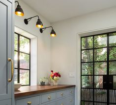 The Architect Is In: A Brooklyn Brownstone Transformed, with Respect - Remodelista Grey kitchen with butchers block tabletop. J'aime beaucoup l'effet que les luminaires ont au-dessus du comptoir Brooklyn Brownstone, New Kitchen, Kitchen Decor, Kitchen Grey, Gold Kitchen, Awesome Kitchen, Beautiful Kitchen, Kitchen Storage, Kitchen Paint