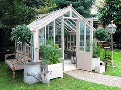 Victorian greenhouse, potting shed, hinged glass skylight, wrought iron roof peak