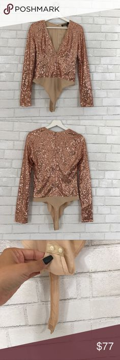 Long sleeve rose gold sequin bodysuits Size M, button button, hidden zipper back. Polyester nylon fabric. Deep Vneck Chest.  New with Tag Rose gold   Ⓜ️Chest 36 Ⓜ️length 29 Ⓜ️Sleeve 26  ✅Bundle and save  ✅🚭 🚫No Trading 🙅🏻 Poshmark rules only‼️ REHAB Tops